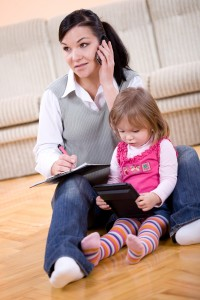 photo of mother working at home with daughter